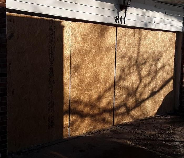 Boarded up garage door